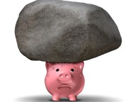 18410794 - financial pressure and the emotional stress of money worries business savings concept caused by the burden of heavy debt with a worried piggy bank supporting a giant rock