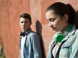 Unhappy teenage boy and teenage girl